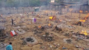 India's crematoriums overflow with victims, with pyres burning through the night